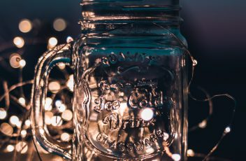 shallow-focus-photograph-of-clear-glass-mason-jar-with-fairy-701336