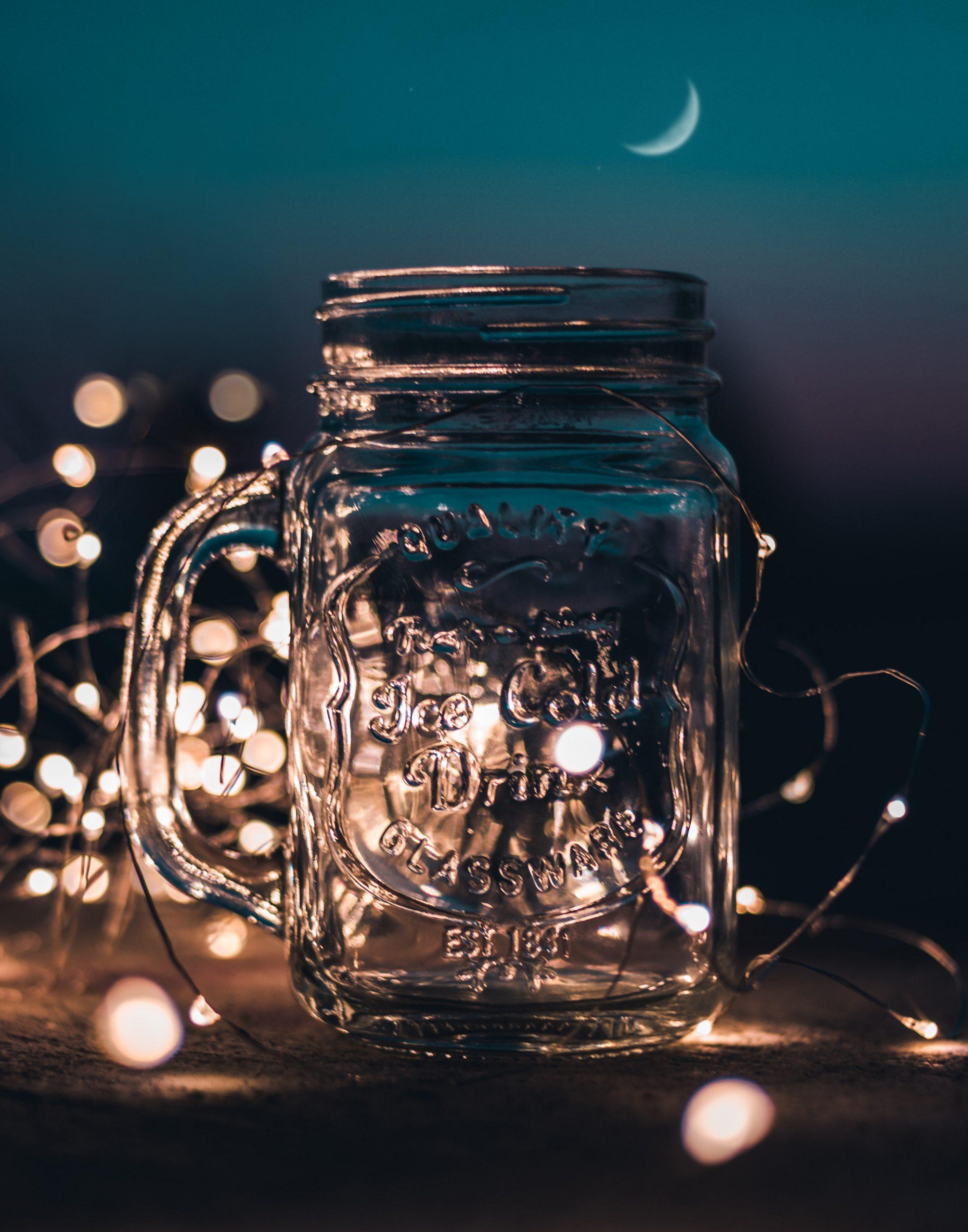 shallow-focus-photograph-of-clear-glass-mason-jar-with-fairy-701336